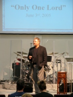 Lowell speaking at Trinity